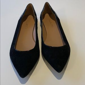 Black suede and patent leather ballet flats